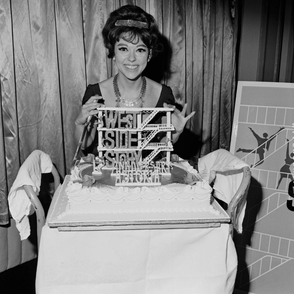 Rita Moreno with a cake dedicated to 'West Side Story', 1963.