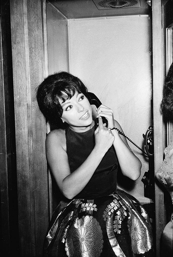 Rita Moreno speaks on the telephone after winning the 'Actress In a Supporting Role' award for the film 'Westside Story', 1962.