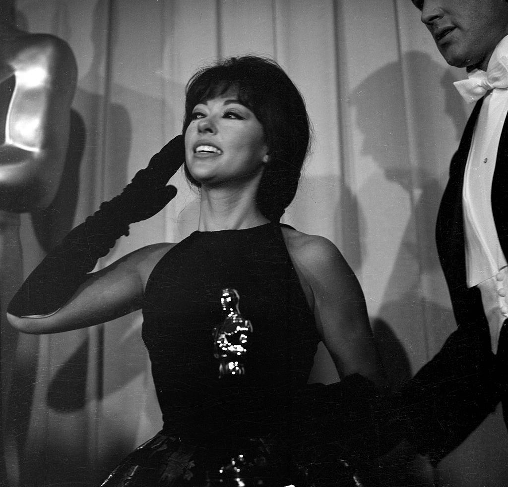 Rita Moreno holds her Oscar during the Academy Awards after winning for 'West Side Story' in Los Angeles, 1962.