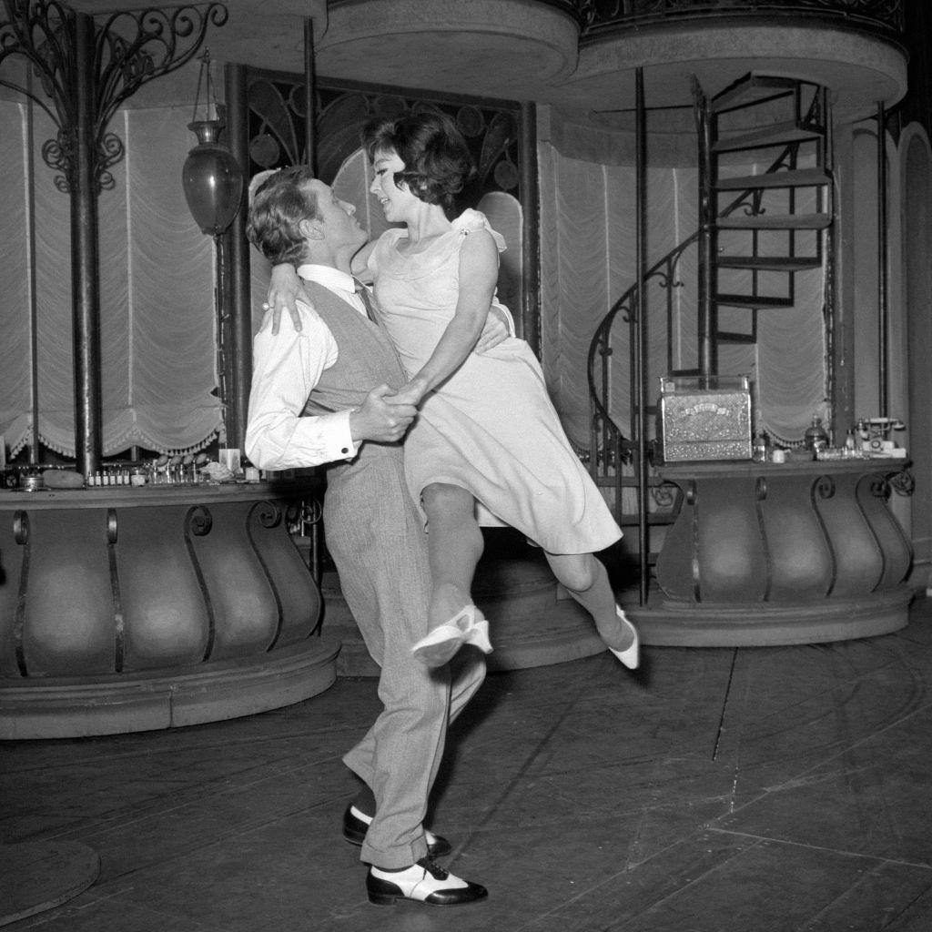 Rita Moreno is swept off her feet by Gary Miller as they rehearse a tango at the Lyric Theatre for a scene in the musical 'She Loves Me', 1964.