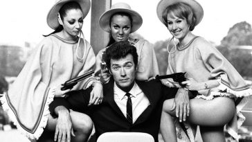 Clint Eastwood with three Beauties in London for the promotion of 'A Fistful of Dollars', 1967