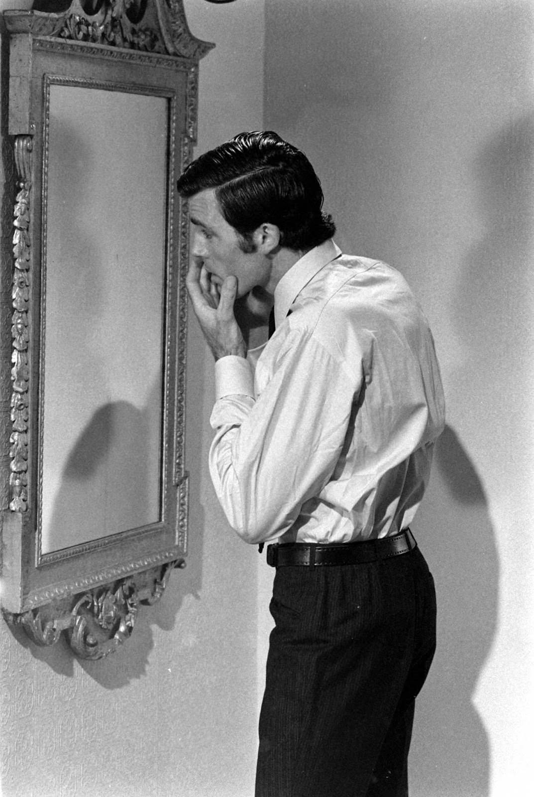 Robert Campbell looks in the mirror between filming scenes for his James Bond audition, 1967.