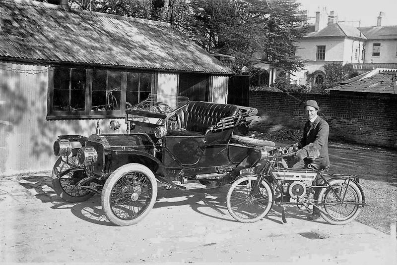 A young man showing off his rides with pride
