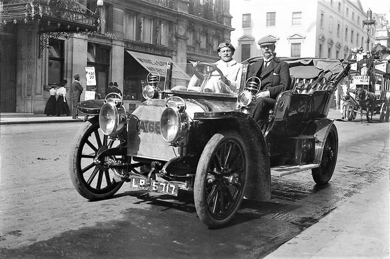 London. William Cochrane and his driver are seen parked across from the Carlton Hotel