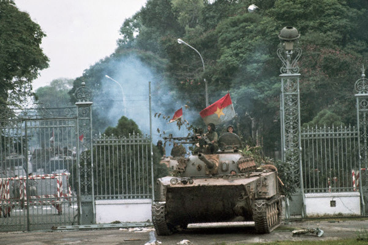 A North Vietnamese tank rolls into a compound during the fall of Saigon, 1975.