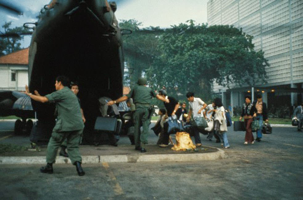 US civilians board helicopter inside the American Embassy compound in Saigon to escape advancing North Vietnamese about to capture Saigon.