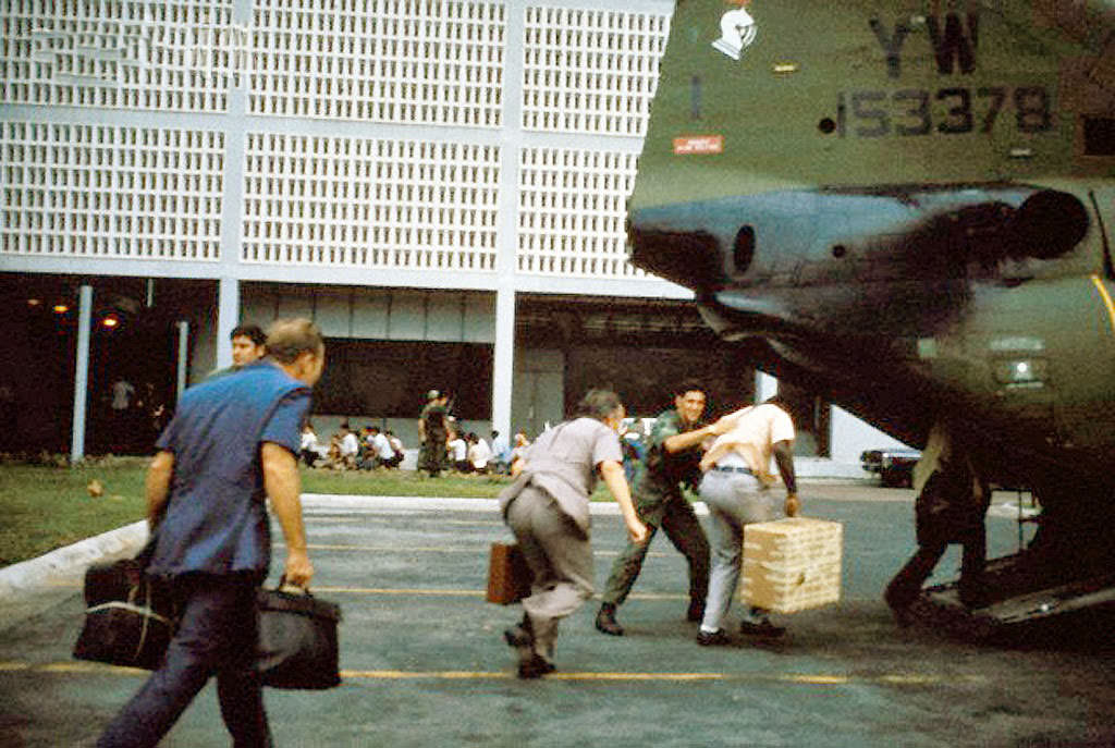 Civilian evacuees board US Marine helicopter inside US Embassy compound to be helilifted to the US Seventh Fleet ahead of Communist troops about to enter Saigon.