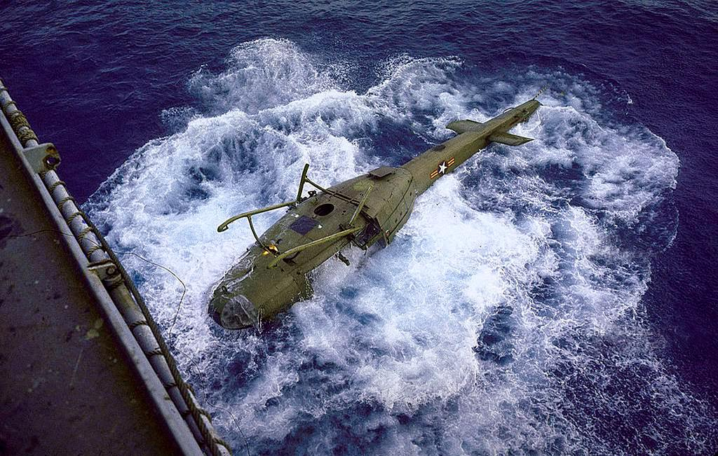 Vietnamese helicopter sinking after being dumped overboard from aircraft carrier to make more room for the evacuation of American personnel from Vietnam during the fall of Saigon.