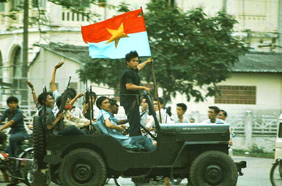 A jeep willis with on board elements of the GRP (Provisional Revolutionary Government) South Vietnamese traverses Saigon announcing the arrival of the north-Vietnamese tanks.