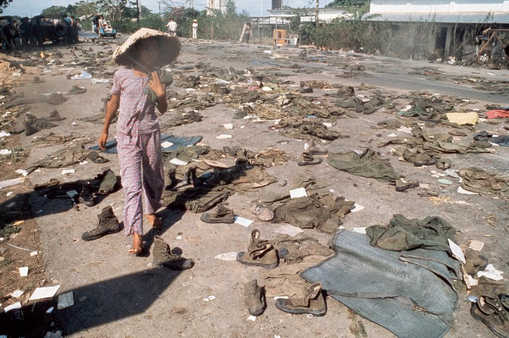 Abandoned uniforms of South Vietnamese soldiers lie on the road after the invasion of North Communist troops which led to the Fall of Saigon.