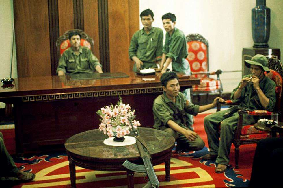 Saigon in Vietnam on April 30, 1975 - G.P.R soldiers and North Vietnamese soldiers in Doc Lap palace after the fall of Saigon on April 30,1975