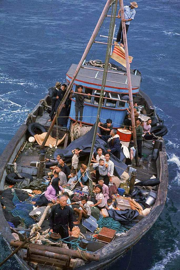 South Vietnamese refugees approach a U.S. war ship to seek refuge from the invading force from the North April 1975 in the South China Sea near Saigon.