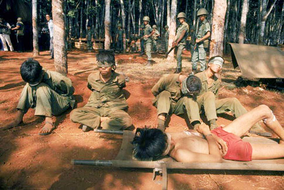North Vietnamese troops are blindfolded and held under guard April 1975 in Saigon.