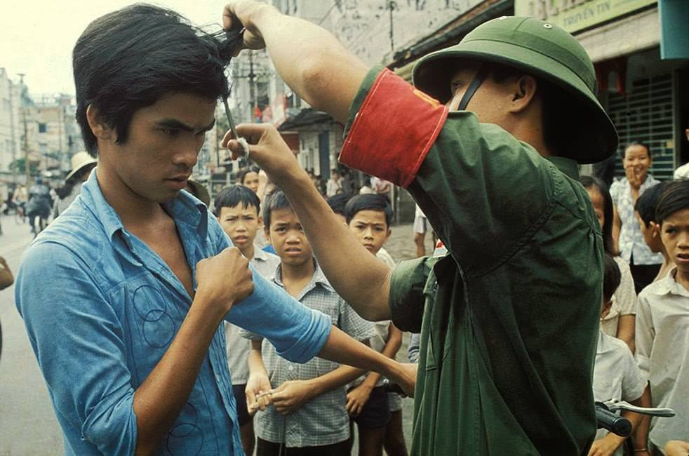 """The Vietcong cutting hair and """"western"""" clothes."""