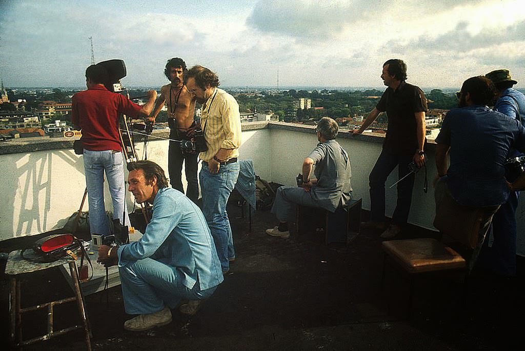As Saigon falls to the communist rule of North Vietnamese, reporters cover the story April, 1975 from a roof top.