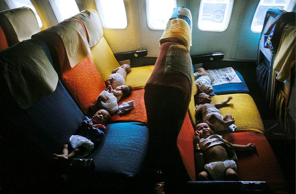 South Vietnamese babies on a flight from Saigon to the USA (probably San Francisco) during Operation Babylift.
