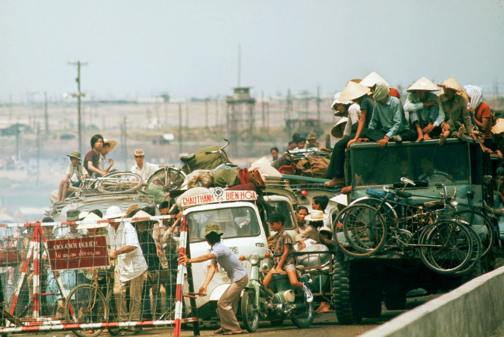 A street congested with traffic as refugees flee in automobiles to Saigon near the end of the Vietnam War.