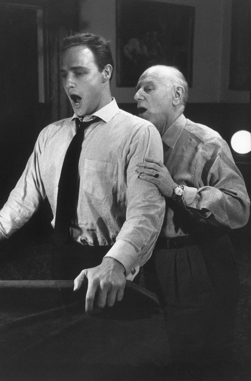 """Marlon Brando practices with his singing coach for his role in """"Guys and Dolls,"""" Goldwyn Studios, 1955"""
