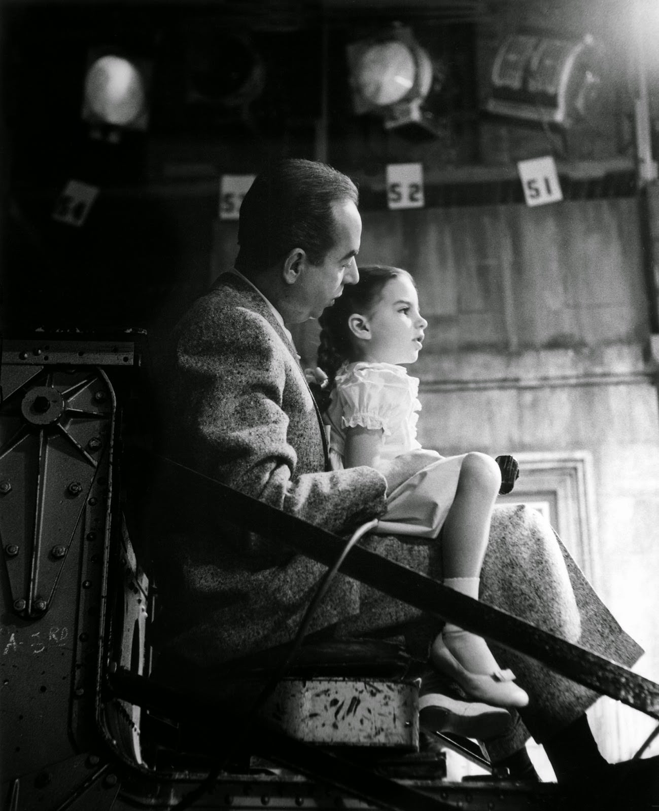 """Vincente Minnelli high on the Chapman crane, takes his daughter Liza Minnelli for a ride on the MGM set of """"Lovely to Look At,"""" 1951"""