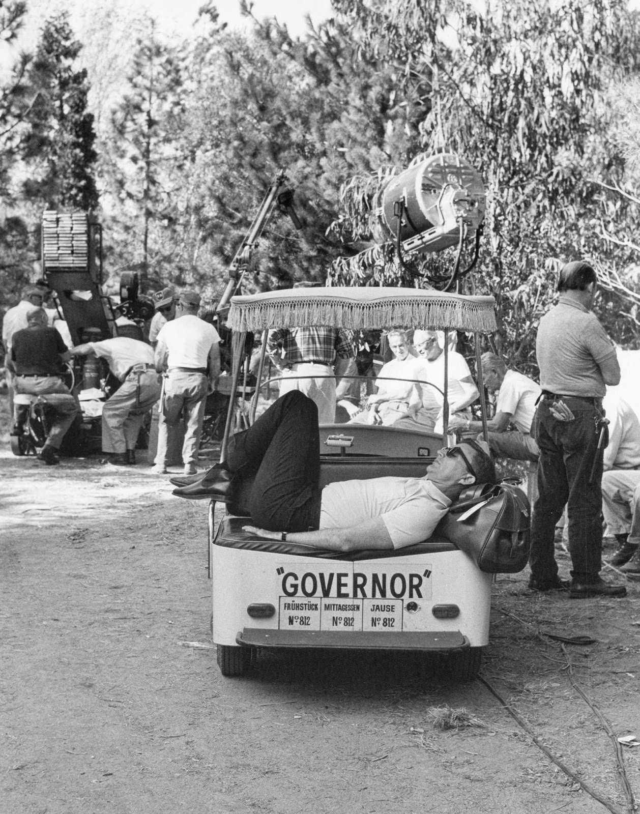 """Director Blake Edwards grabs a nap in a golf cart on location in Salzburg, Germany, for """"The Great Race,"""" 1964"""