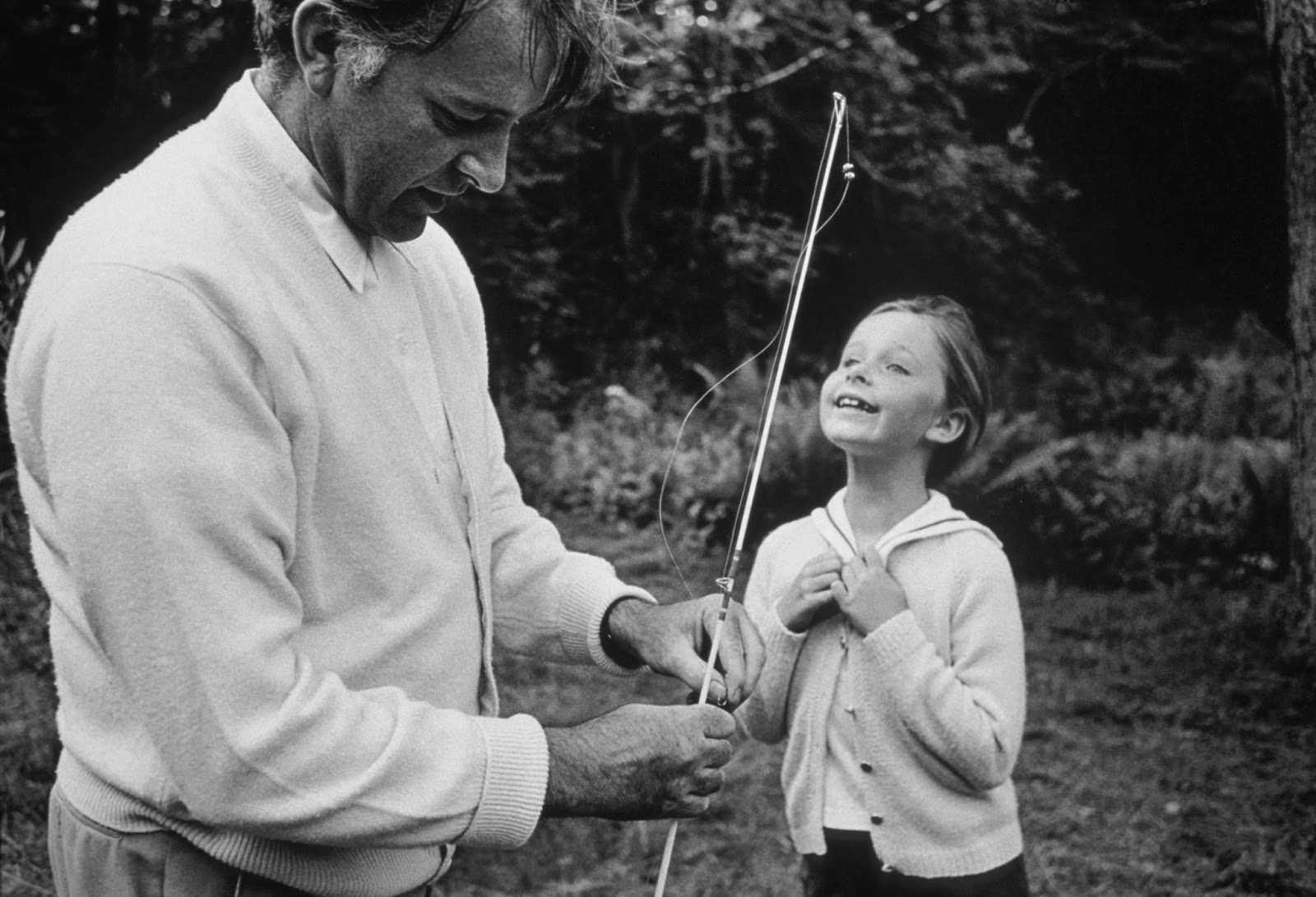 """Richard Burton teaches his daughter Kate to fish on location in Northampton, Massachusetts, during filming of """"Who's Afraid of Virginia Woolf?"""", 1965"""