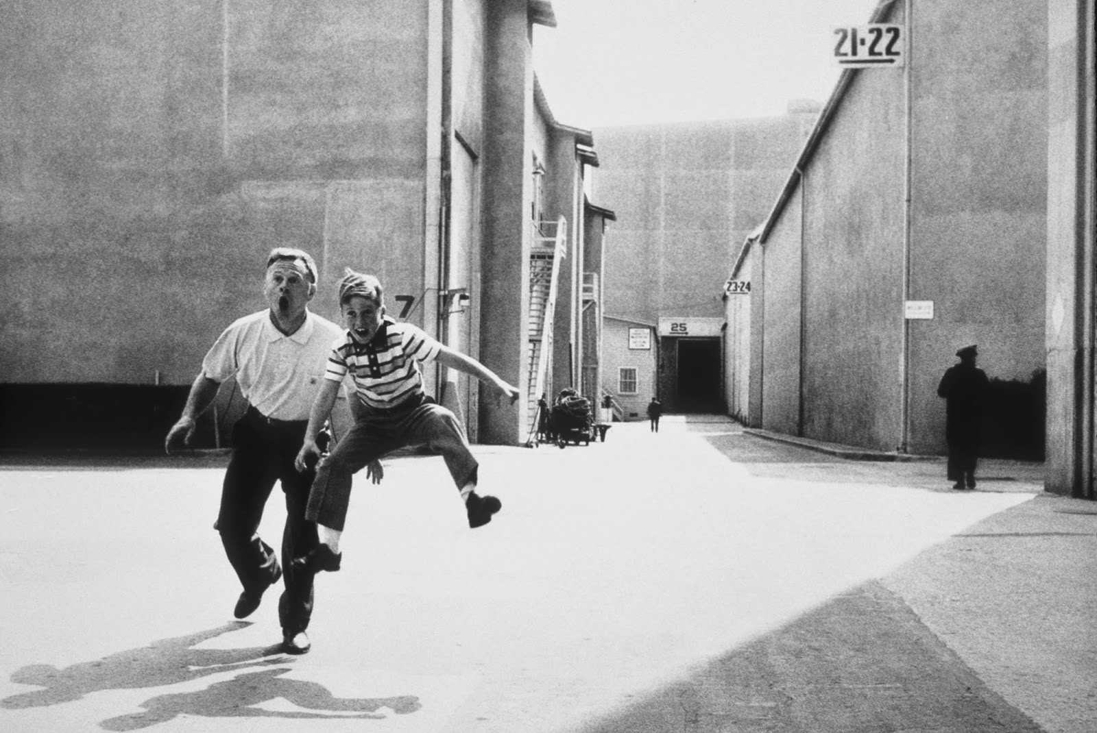 Mickey Rooney and his son Teddy jumping for joy on the MGM lot in Culver City, 1958