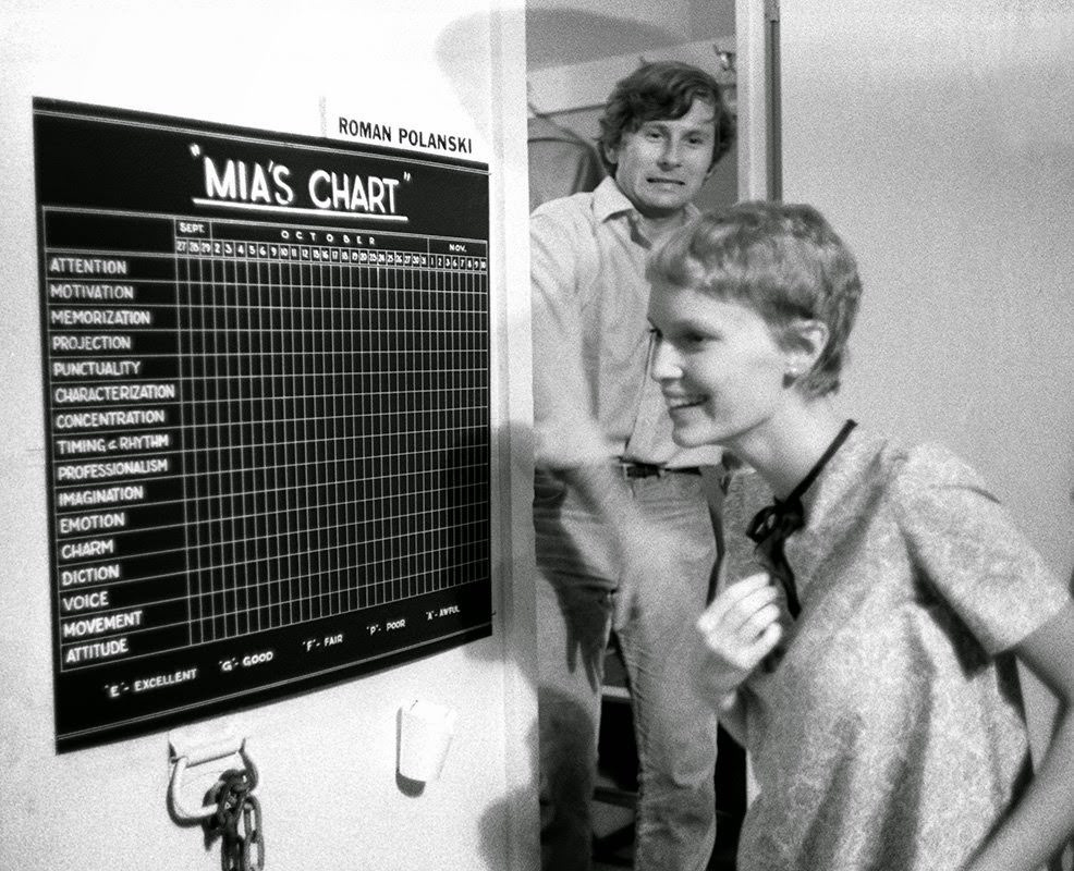 """Roman Polanski with Mia Farrow as she discovers her chart on the Paramount set of """"Rosemary's Baby,"""" 1967"""