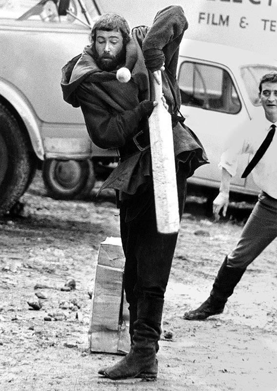 """Peter O'Toole dressed for his role as King Henry II, tries his hand at cricket on the French location for """"The Lion in Winter 1967"""