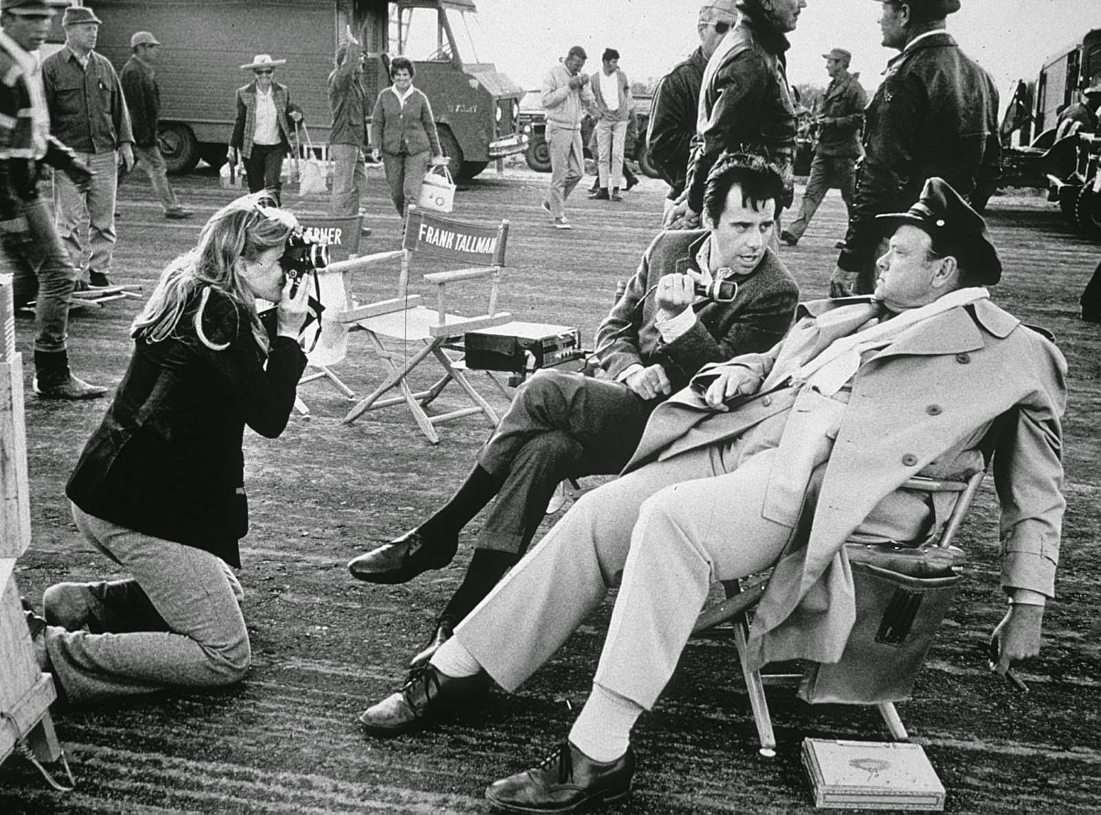 """Candice Bergen visits the """"Catch-22"""" set in Mexico, photographing Peter Bogdanovich as he interviews cast member Orson Wells; 1969"""