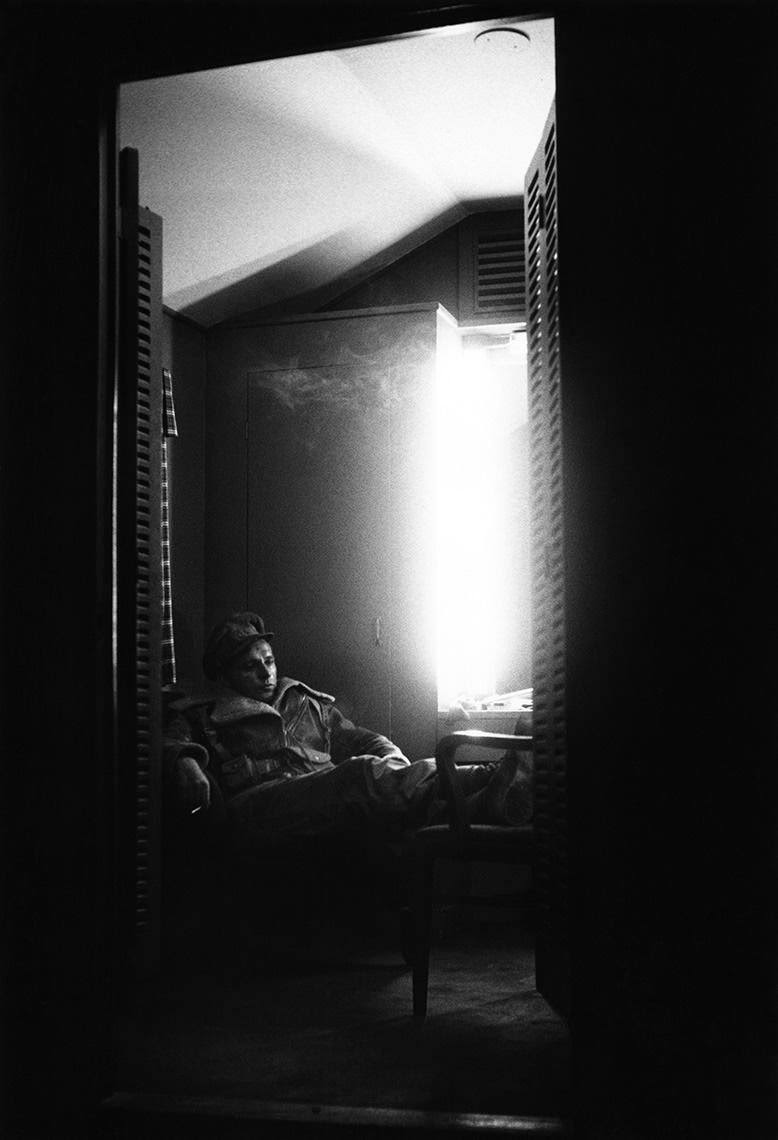 """Richard Burton in his 20th Century Fox dressing room during filming on """"The Desert Rats,"""" 1953"""