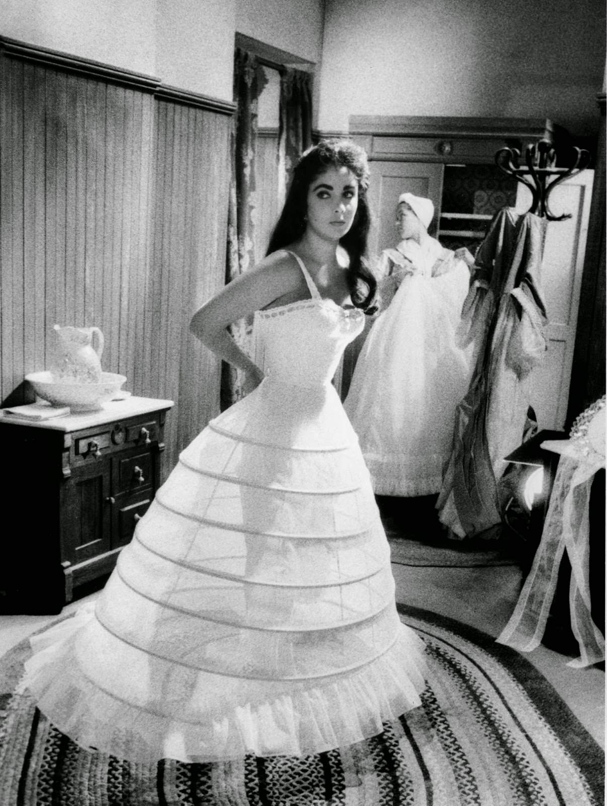 """Elizabeth Taylor dresses for a scene on MGM's """"Raintree County,"""" 1956"""