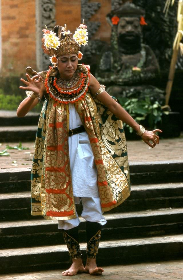 Colorful costume worn by a dancer performing a traditional dance at Kuta Beach, 1970s