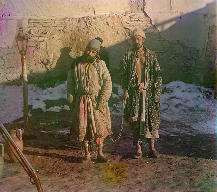 Two prisoners in shackles, ca. 1910s