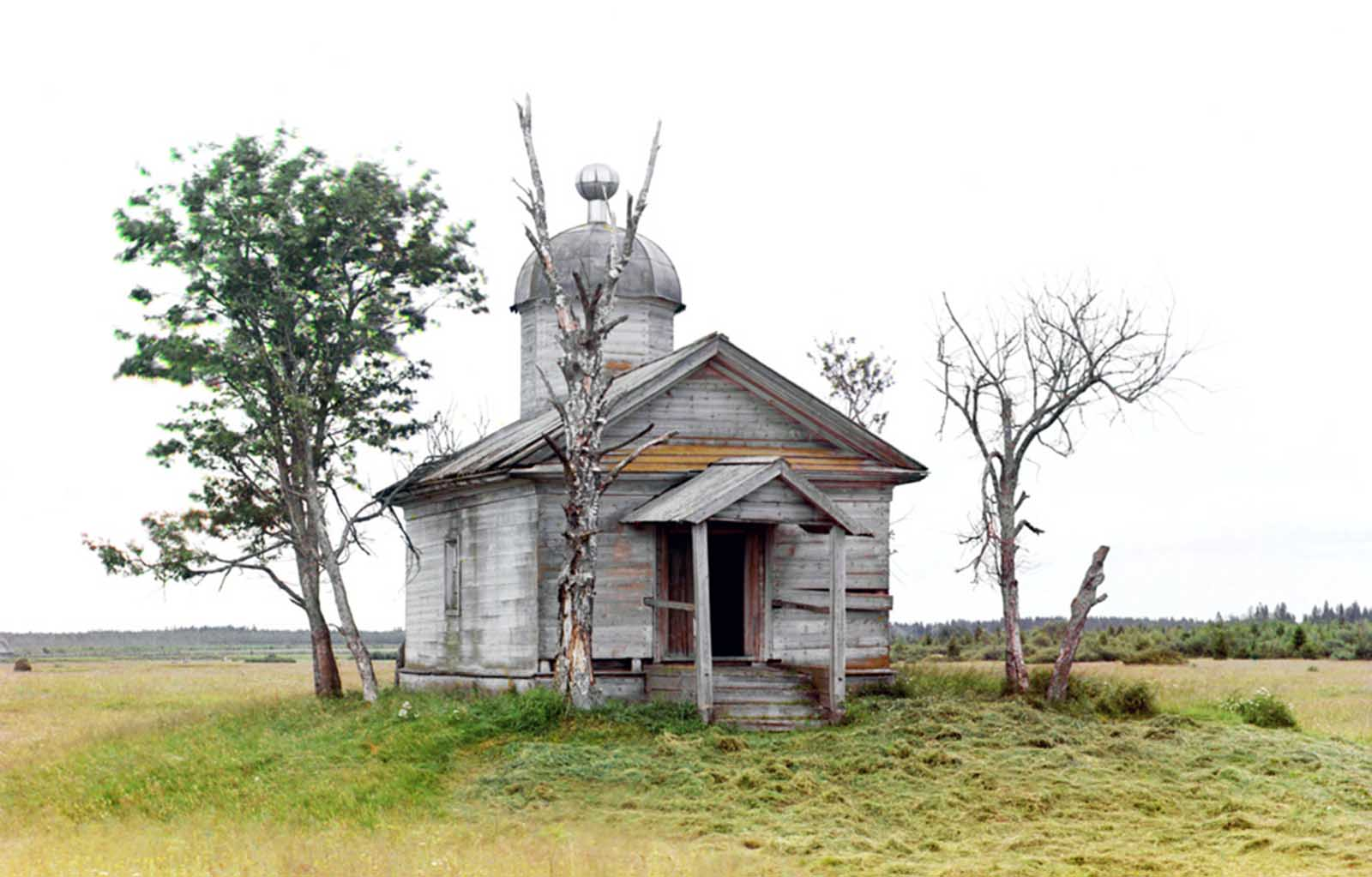 A chapel sits on the site where the city of Belozersk was founded in ancient times, photographed in 1909.