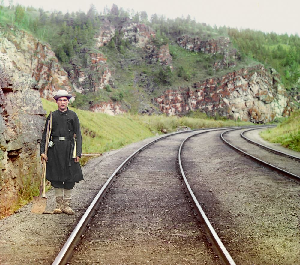 A switch operator poses on the Trans-Siberian Railroad, near the town of Ust Katav on the Yuryuzan River in 1910.