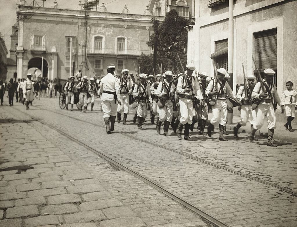 Crew of USS Denver Marching Through Streets, 1890.