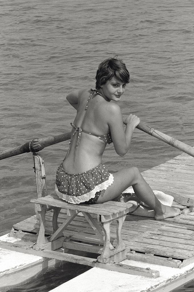 The actress Rossana Podestà wearing a swimsuit, on a rowing boat in Venice, during the 17th Venice Intenational Film Festival. Venice (Italy), 1956.