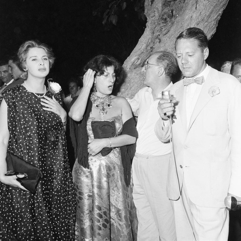 Oscar winning Italian actress Anna Magnani (centre), pictured at her cocktail party, held at the Golf Club Lido di Venezia.