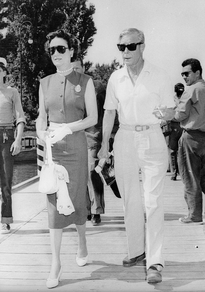 The Duke and Duchess of Windsor take a stroll at the Lido, Venice, where they are attending the International Film Festival, 1956.