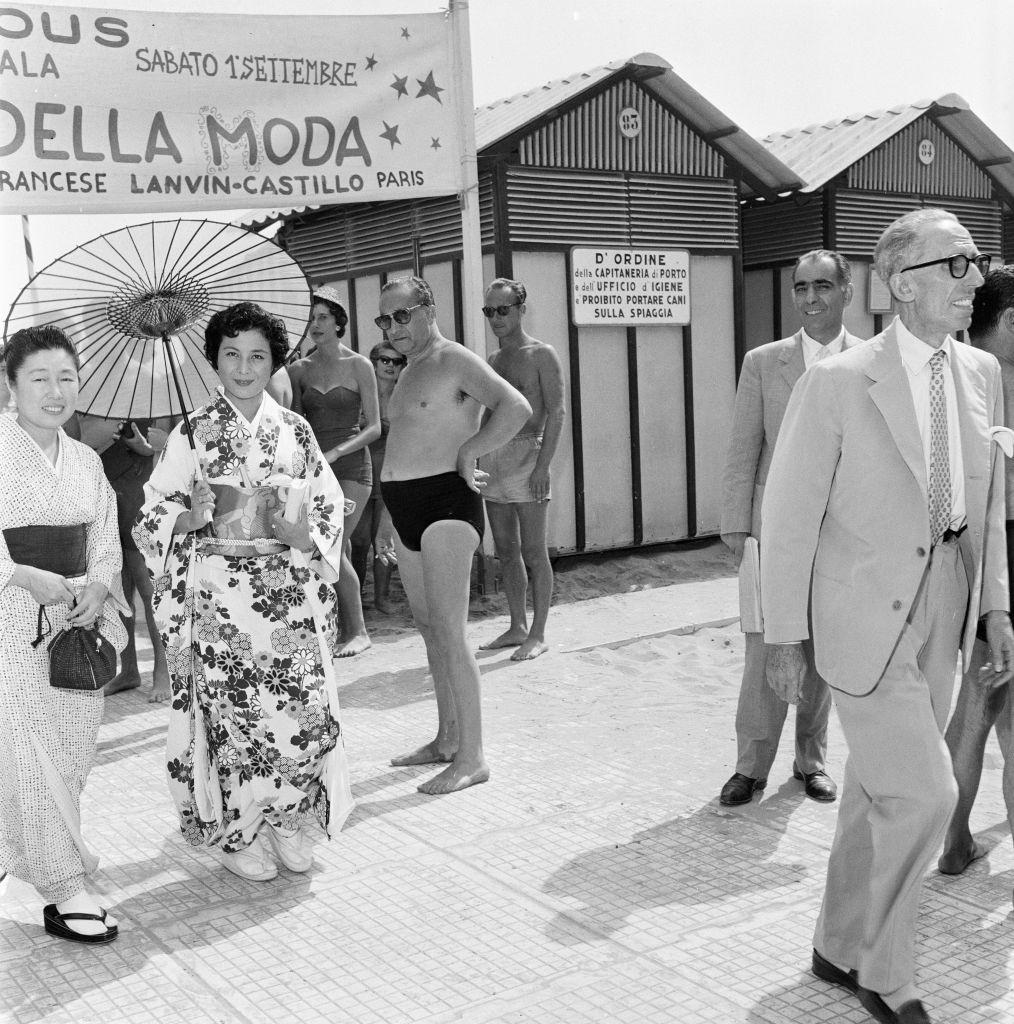 Japanese woman wearing traditional outfit with Parasol at 1956 Venice Film Festival.
