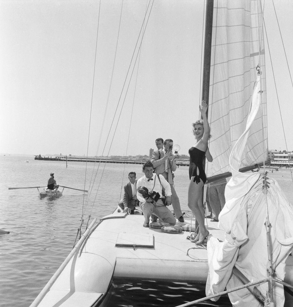 Italian actress Sandra Milo poses for pictures on a Catamaran.