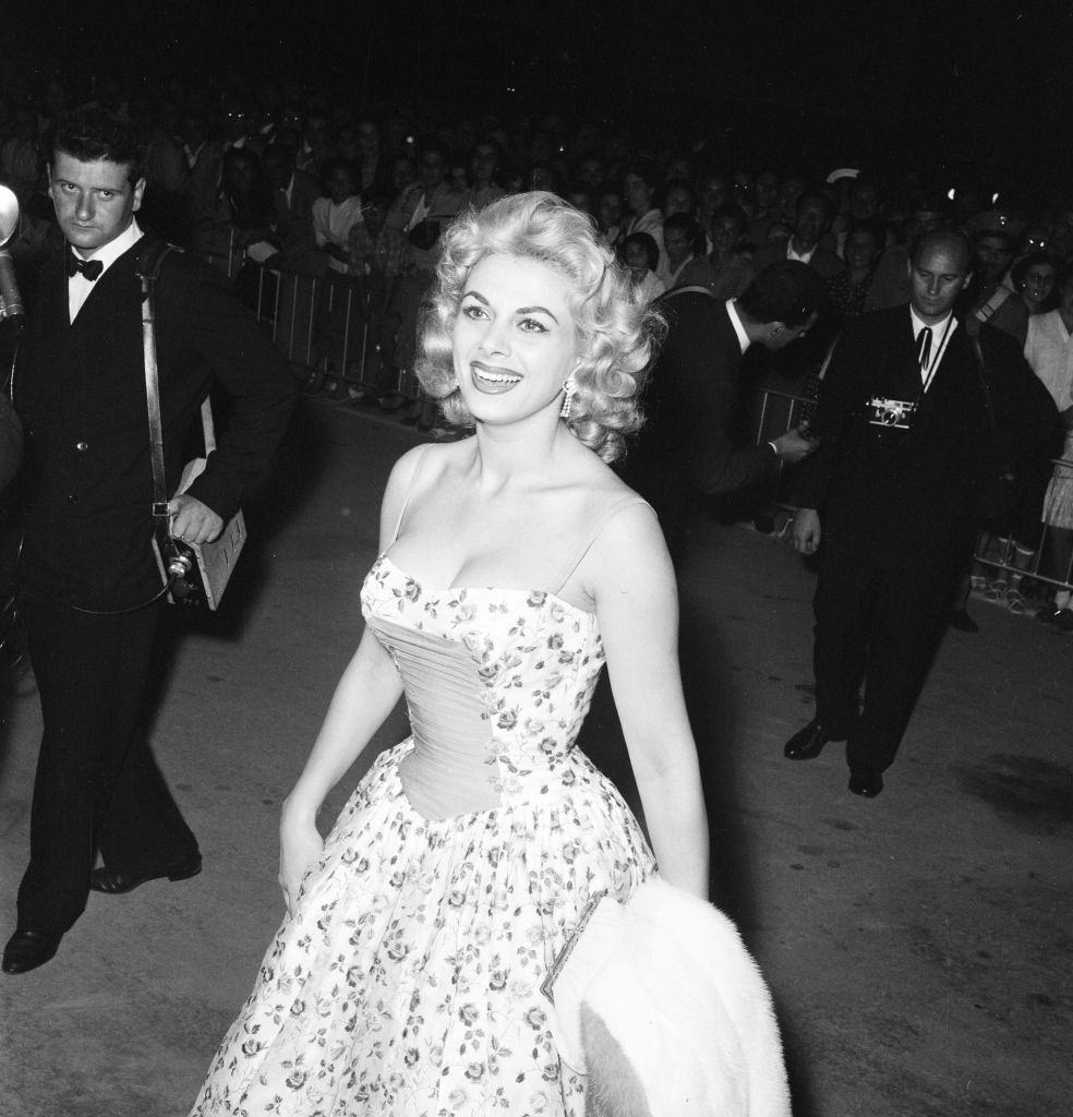 Italian actress Sandra Milo arrives at the Casino, applauded by fans and a member of the Italian navy. Venice Film Festival, Friday 31st August 1956