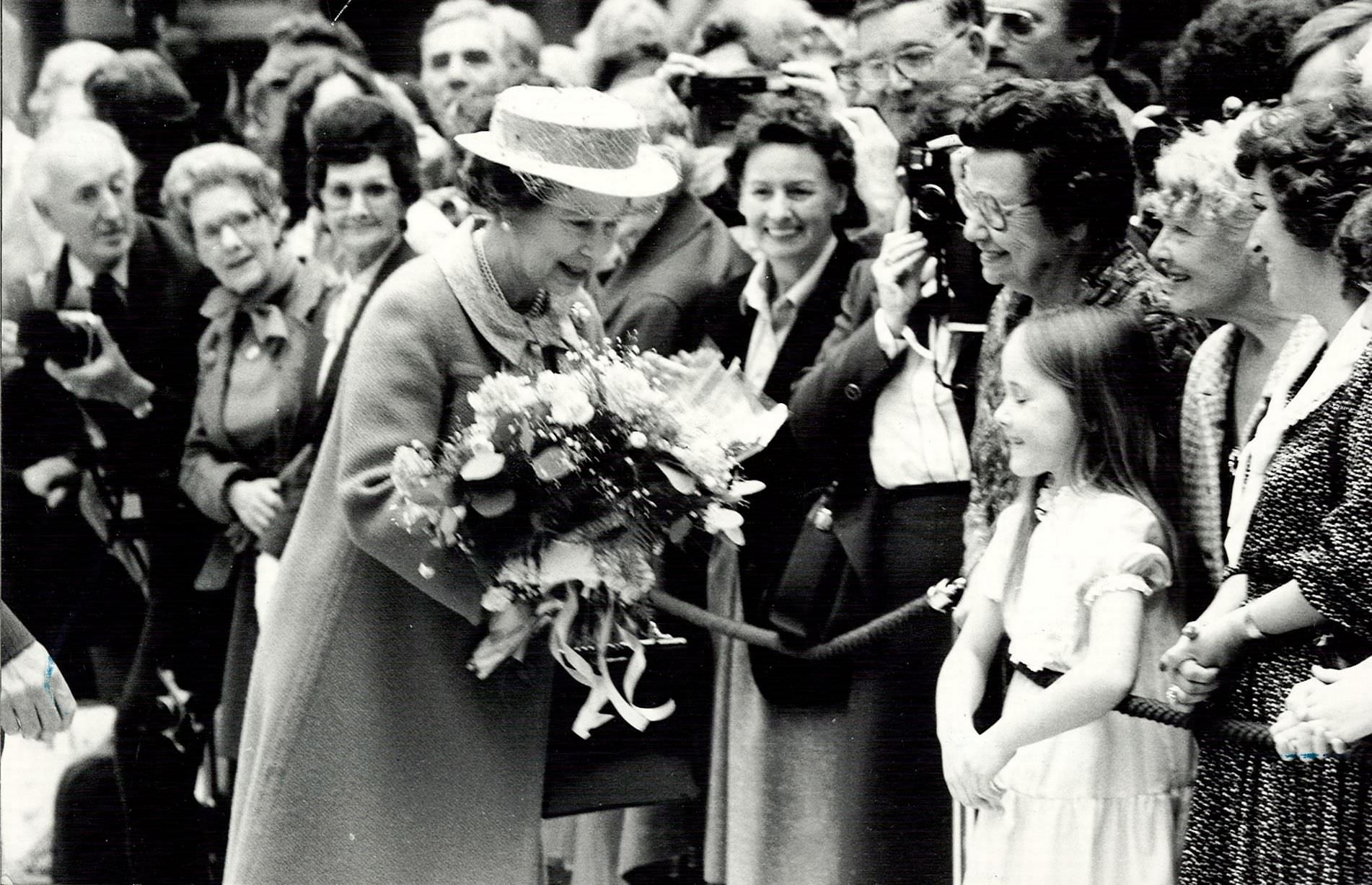 The Queen receiving flowers from the crowd at the opening of Birmingham International Airport, 20th May 1984.