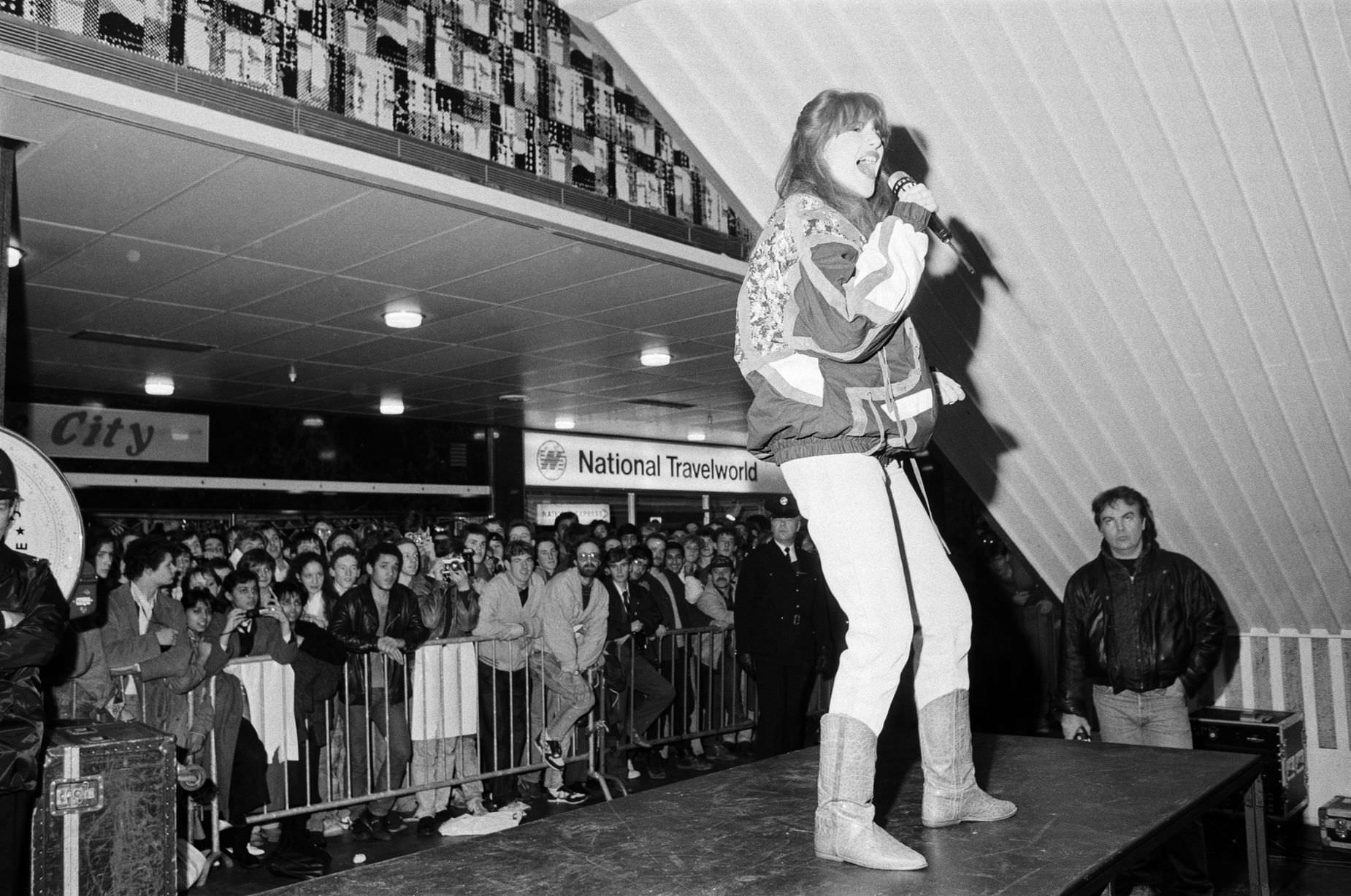 Thousands of young pop fans gather at the Bull Ring Shopping Centre for pop singer Tiffany, 19th January 1988.