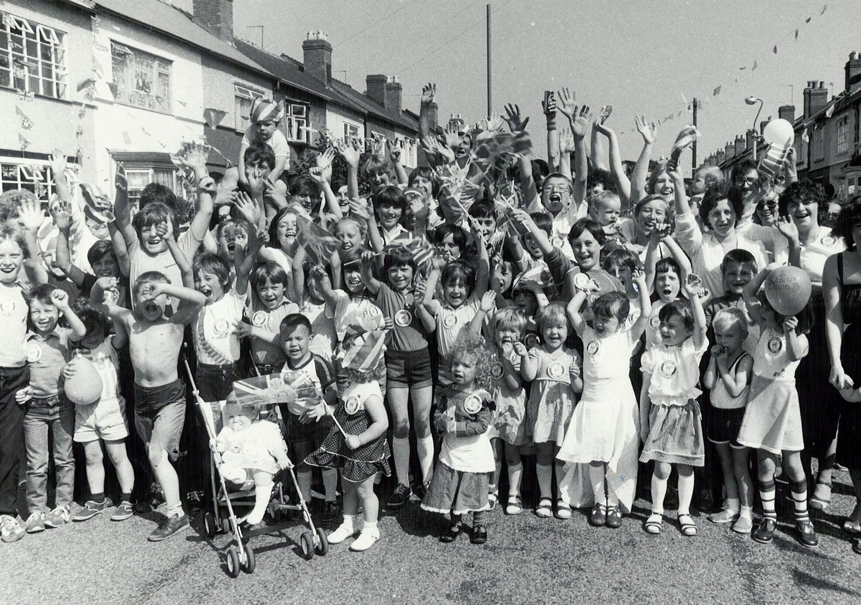Street party for the Royal Wedding of Prince Charles and Lady Diana Spencer at Blythswood Road in Tyseley who set up a rousing cheer as their party got underway. 29th July 1981.