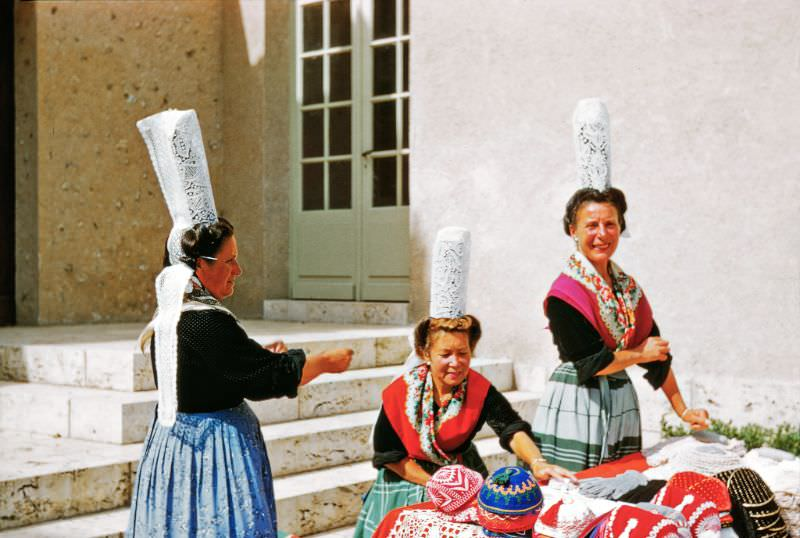 Lacemakers in traditional dresses outside Chartres Cathedral, Chartres, 1958