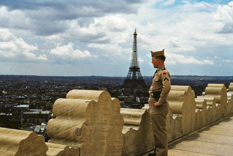 View towards the Eiffel Tower from the Arc de Triomphe (the soldier is Canadian), 1953