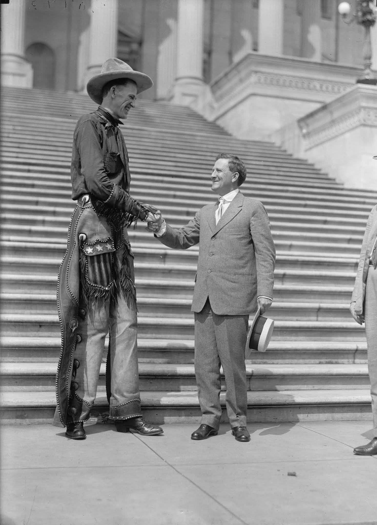Madsen shaking hands with Senator Morris Sheppard at the capitol. 1919.