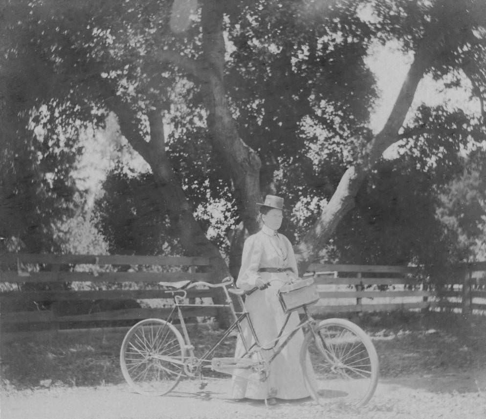 Woman with tandem bicycle, 1897.