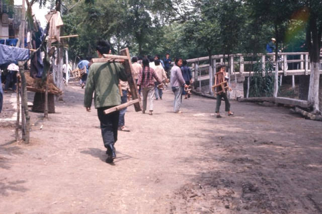 Commune carrying benches to meeting, Shanghai, 1970s